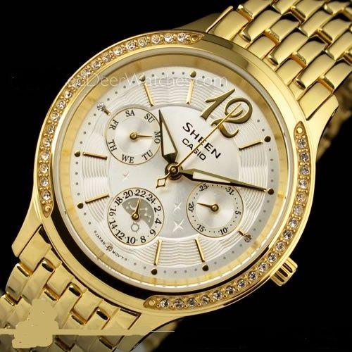 Bonito reloj dorado,con semanario,fecha, y cristalitos SWAROVSKI en el borde de la caja