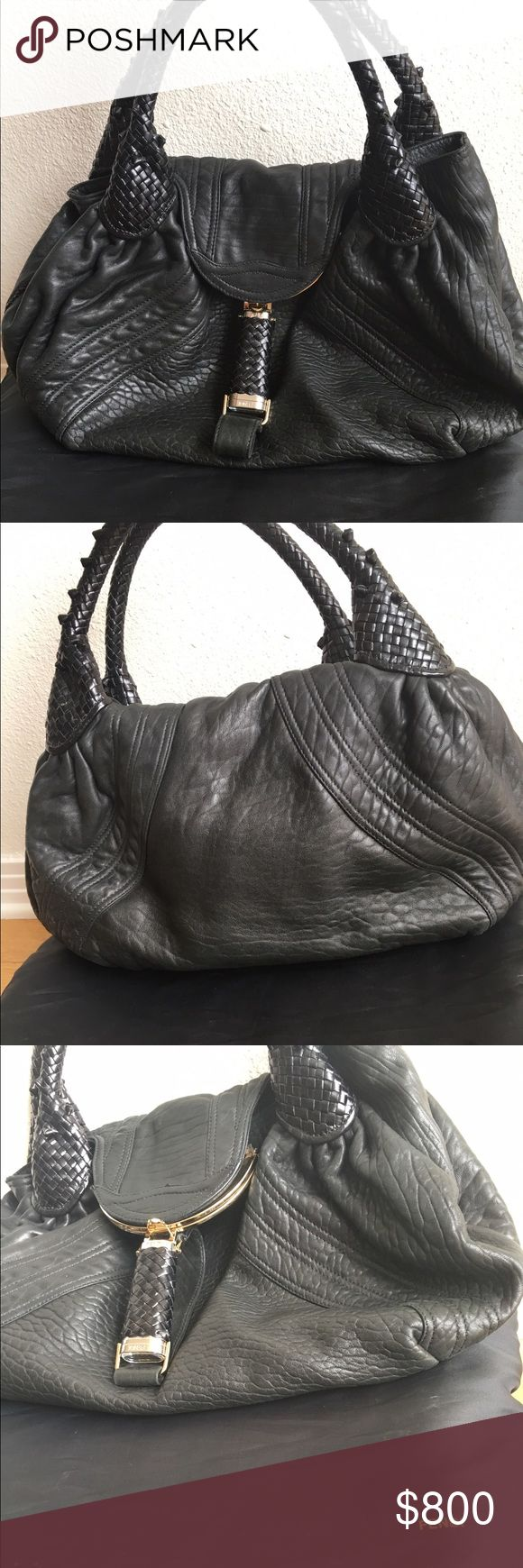 Authentic black Fendi Spy Bag This black Fendi spy bag is brand new. I have only used this spy bag a couple of times. It has been sitting in a dust bag and there is no damage at all. It looks brand new and comes with its original dust bag. All black and gold accents. This is the bigger version. Fendi Bags Shoulder Bags