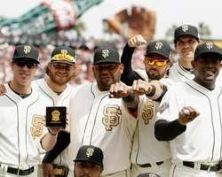 Players of the San Francisco Giants show off their 2012 Championship rings before their game against the St. Louis Cardinals at AT Park