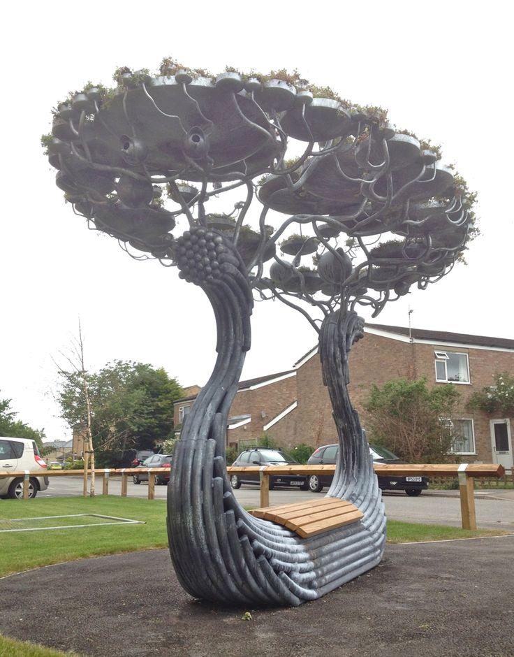 Amazing sanctuary sculpture. sedum, bird houses, hedgehog home,metal, oak, bench, boat. more info at www.sanderson-sculpture.com