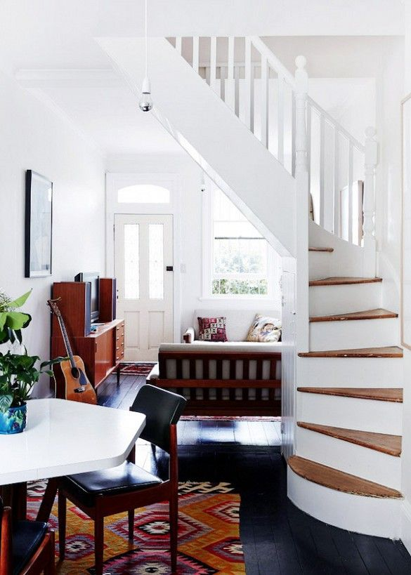 White spiral staircase off of living room.