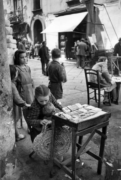A girl cigarette vendor. Photograph by Alfred Eisenstaedt. Naples, Italy, 1947.