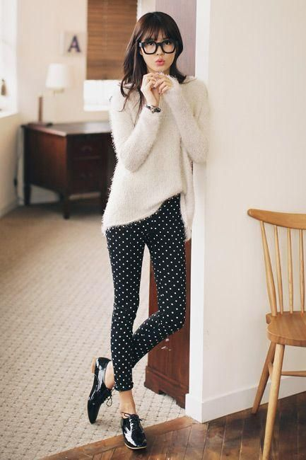 Business casual work outfit: white sweater, black and white polka dot pants, black oxfords.