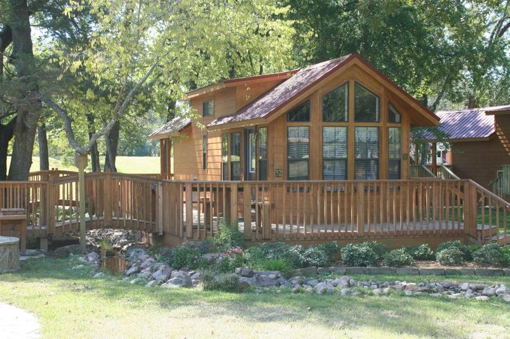 This park model would be perfect for a little home in the woods cabin homes park models - The recreational vehicle turned cabin in the woods ...