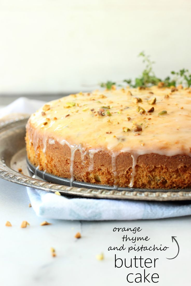 ORANGE THYME AND PISTACHIO BUTTER CAKE  A delicious, moist yellow butter cake with orange zest and fresh thyme. Crunchy pistachios and a sweet orange glaze make this perfect for brunch or tea.