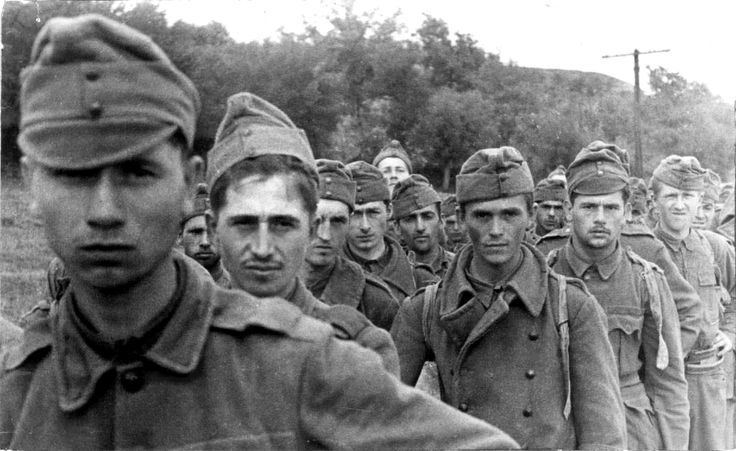 Axis Hungarian soldiers taken as POWs by Soviet forces at the first Battle of Voronezh are photographed at a prisoner of war collection center. The battle was a fought in and around the strategically important city of Voronezh on the Don river, 450...