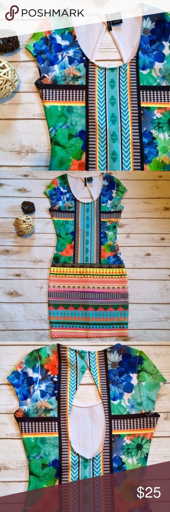 Floral Aztec Print Body Con Dress NWOT - this dress is in excellent condition! It is tight, stretchy, colorful, comfortable, and perfect for warm weather ☀️ The back features a cut out design. Fire Los Angeles Dresses Mini