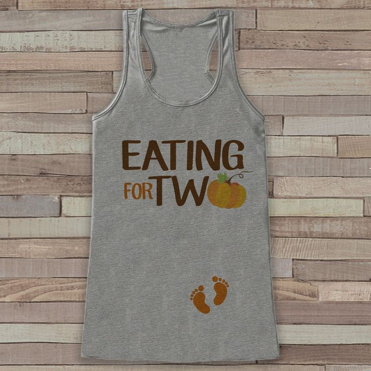 This fun tank top is the perfect way to announce your pregnancy! Tank is a soft poly blend with a flattering draped silhouette, round neck and racerback. **This tank is not a maternity style, however,
