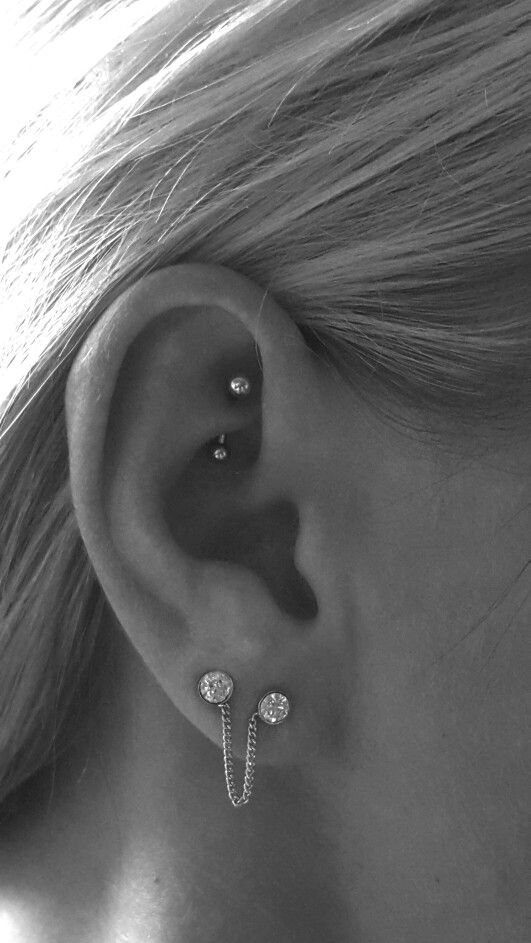 Love the chain jewelry for the ear lobe piercings. And, I love the Rook piercing, too. :)