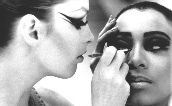 Polly Maggoo applying make up to Donyale Luna