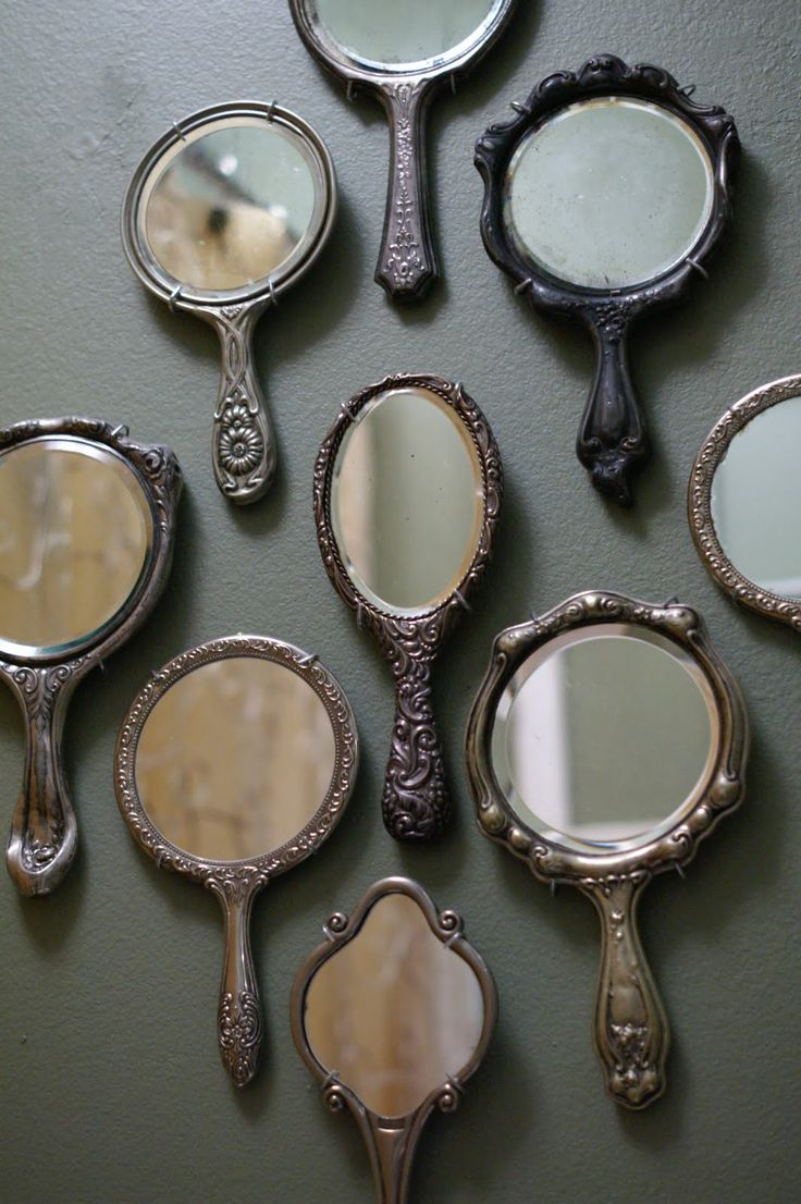 I love the idea of using multiple vintage hand held mirrors as wall decorations.