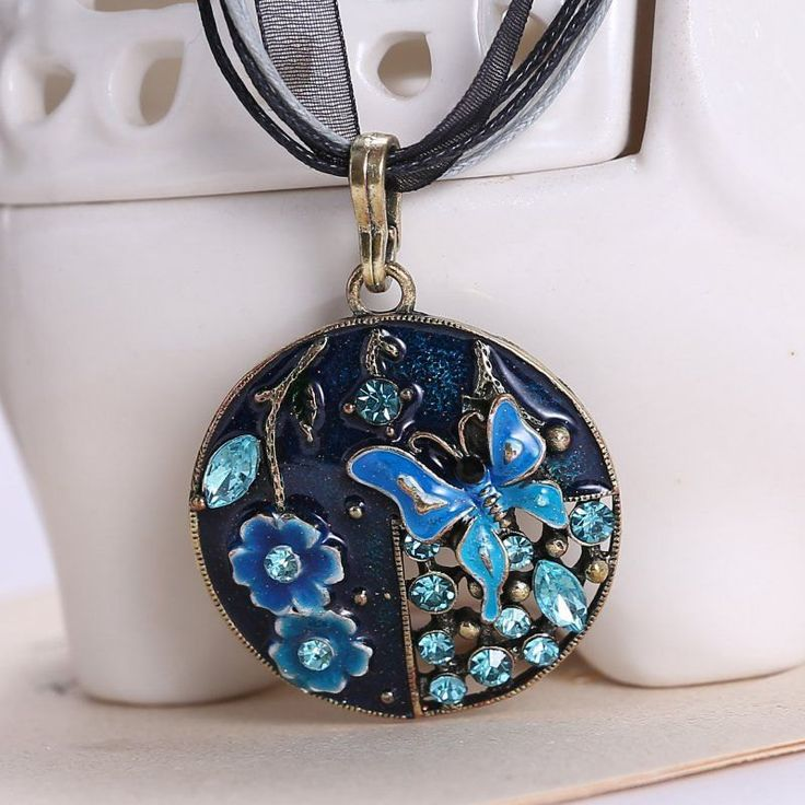Chunky Retro Blue Butterfly and Flowers Rhinestone Steampunk Inspired Pendant on Black Leather and Lace Chord Necklace - pinned by pin4etsy.com
