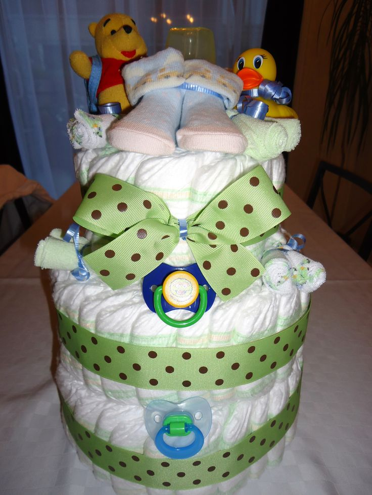 Diaper cake for boy, pacifier, Winnie the Pooh, rubber duck / Gâteau de couches pour garçon, suces, Winnie l'ourson, canard pour le bain. Order yours here / commandez ici: https://www.facebook.com/creationsdeMarieLou?ref=aymt_homepage_panel #showerbébé #cadeaunaissance #babyshower #birthgift