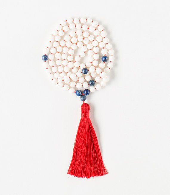 108 White Coral beads Tibetan Buddhist Mala with Lapis Lazuli  Self-Expression Mala  To its wearer Coral gives wisdom and modesty. It is believed that Coral reduce stress and fears and promote a stable family life. The white Coral is capable to repair aura.  Lapis Lazuli open the third eye and balances the throat chakra. Boosts illumination, helps to interpret dreams, develop psychic abilities, facilitates spiritual journey and stimulates personal and spiritual power. Lapis support facing…