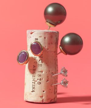Cork as Earring Holder - Marry pairs of earrings. Stick the posts into a cork to keep them together.