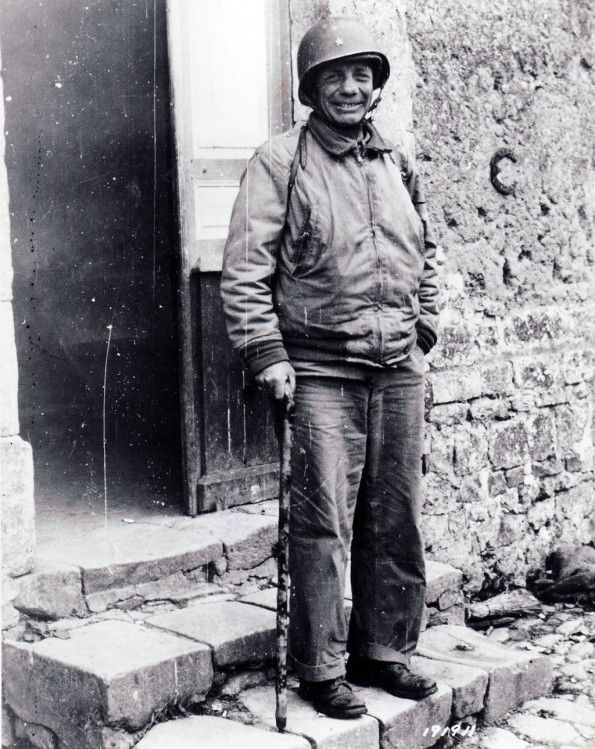 """Brigadier General Theodore Roosevelt, Jr., seen in Ste. Mere-Eglise on July 12, hours before he died of a coronary thrombosis. Arthritis caused him to walk with a stick. The 4th Infantry Division commander described him as """"the most gallant soldier and finest gentleman I have ever known."""""""