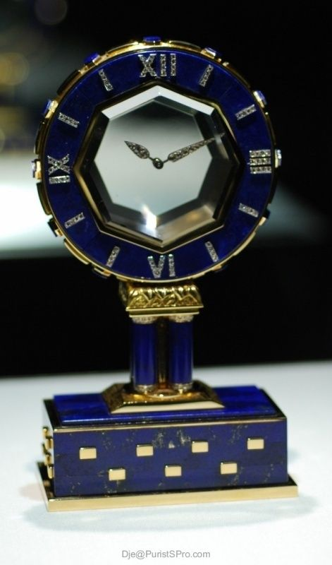 Cartier, Paris. Art Deco Single Axle Mystery Clock. Made for Princess Doan Vinh Na Champassak, nee Miss. Barbara Hutton in 1967 of Yellow  White Gold, Lapis Lazuli, Diamonds and Rock Crystal