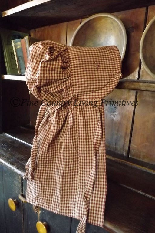 Primitive Handcrafted Prairie Bonnet made of burgundy checked homespun.  Available for sale on our website.