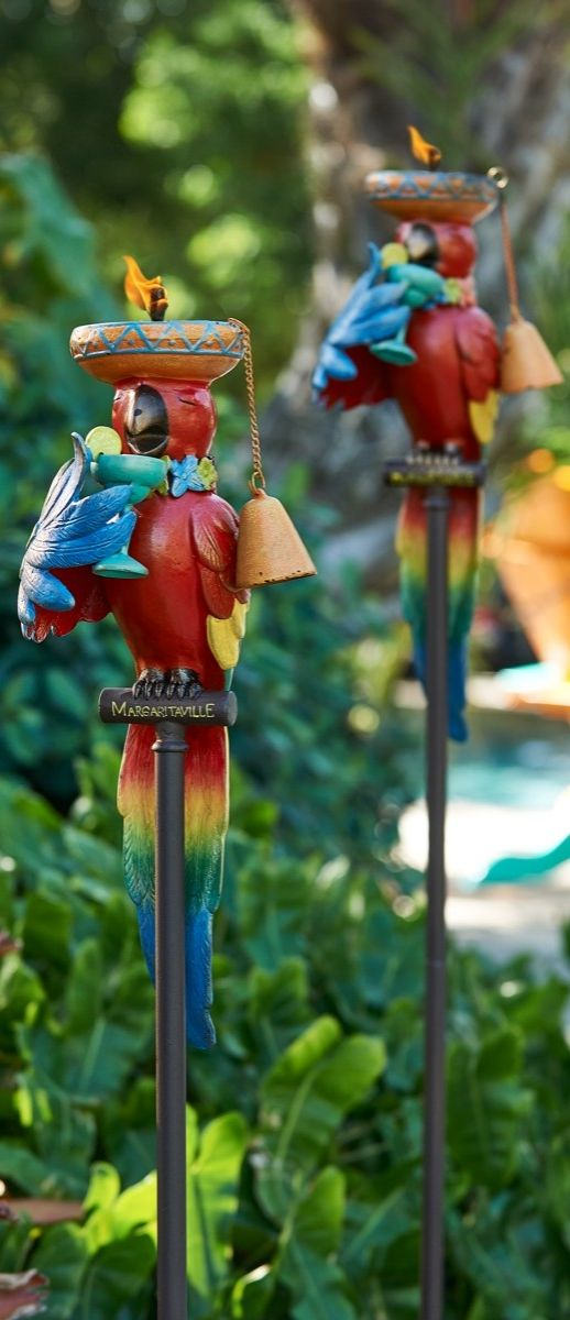 Constructed of aluminum and topped with a whimsical, feathery friend, this tropical torch adds color and light to your outdoor area. | Margaritaville by Frontgate