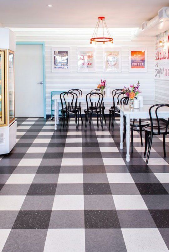 Vinyl linoleum tiles can actually look good really for Black linoleum flooring