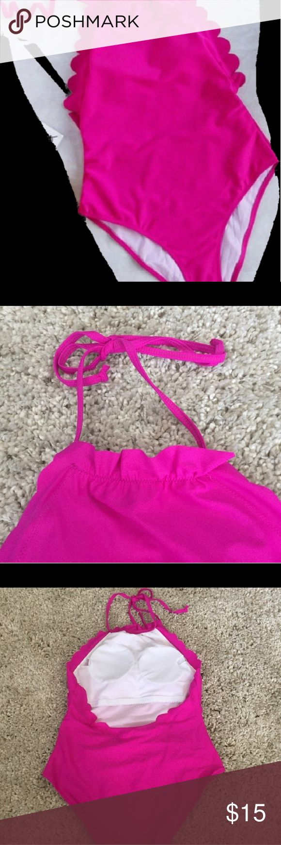 NEW Hot Pink scalloped one piece swimsuit New hot pink scalloped one piece with original packaging and liner didn't come with price tags this suit is the cutest one piece but it was too small on the top for me it has opened back detail and halter neck with removable cup pads waist: 14 inches across, hips: 16 in across, length without halter tie: 23 in Swim One Pieces
