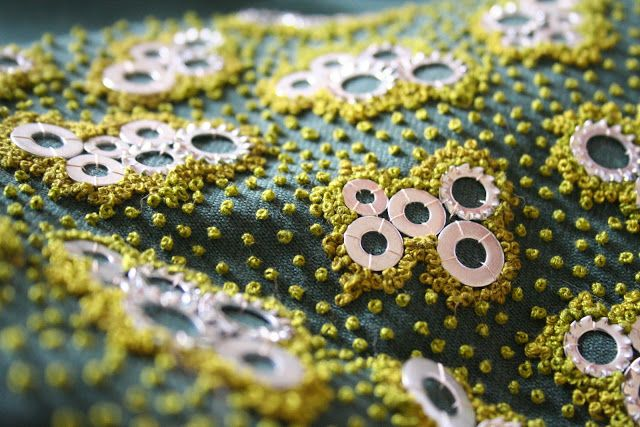Brilliant use of French knots and ... washers? Vivid colour, texture, and form abound in this piece by French textile artist Morgane Leboeuf.