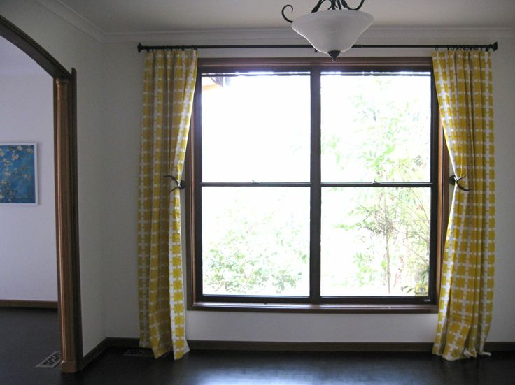 """Yellow in the dining room... DIY curtains in my """"Hollywood Crossing"""" print, with antler tie backs."""