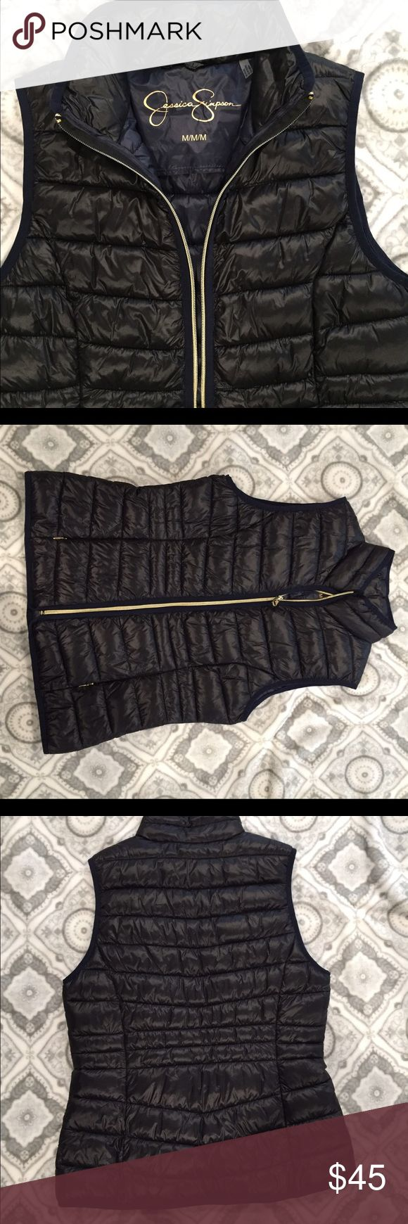 Jessica Simpson black vest Black warm vest with dark blue and gold trim. This is brand new never worn, tried on but was too big however I had already removed the tags because I was sure I was going to keep it. It is true to size M looks great with everything Jessica Simpson Jackets & Coats Vests