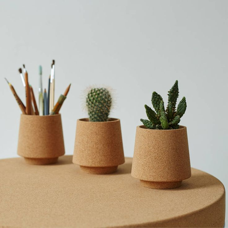 Hand turned stackable cork vessels, perfect to use as neat little desk tidies or as small plant pots.