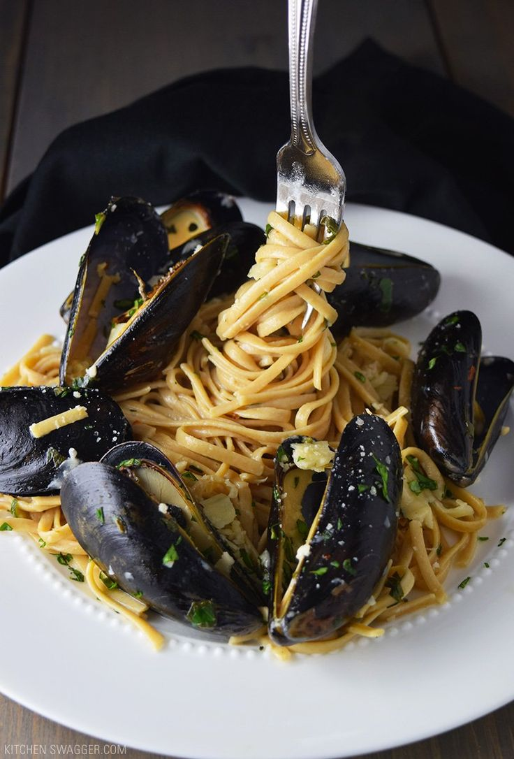 Mussels over linguine with garlic butter sauce is a hearty summer dish served over whole wheat linguine with a cream-based garlic butter and wine sauce.