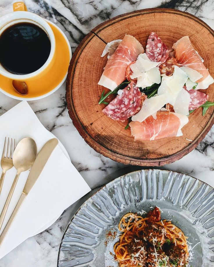 Cold cuts, pasta, and coffee at Emmie's cafe and restaurant in Bangkok Thailand