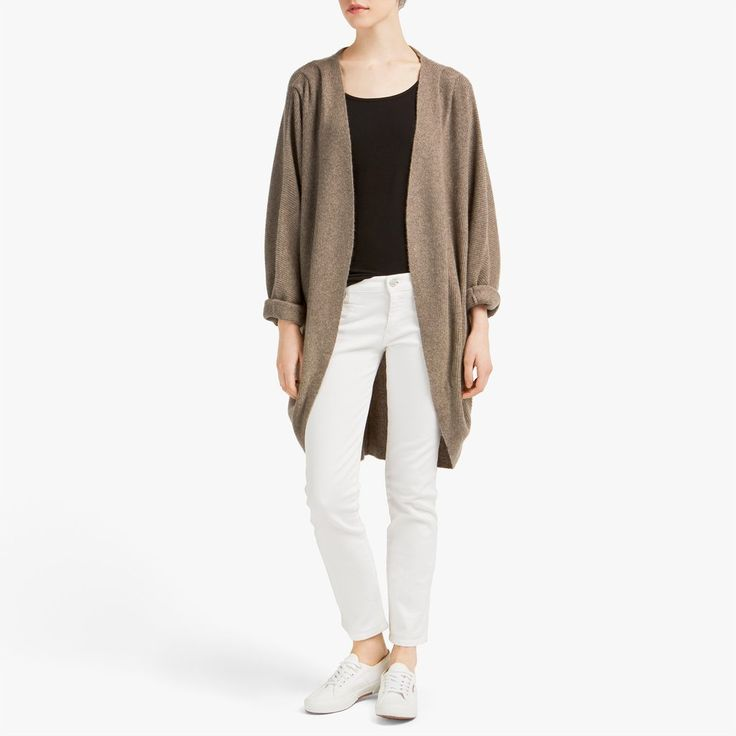Made of the finest cashmere and cut for a boxy fit, this sweater is a true…