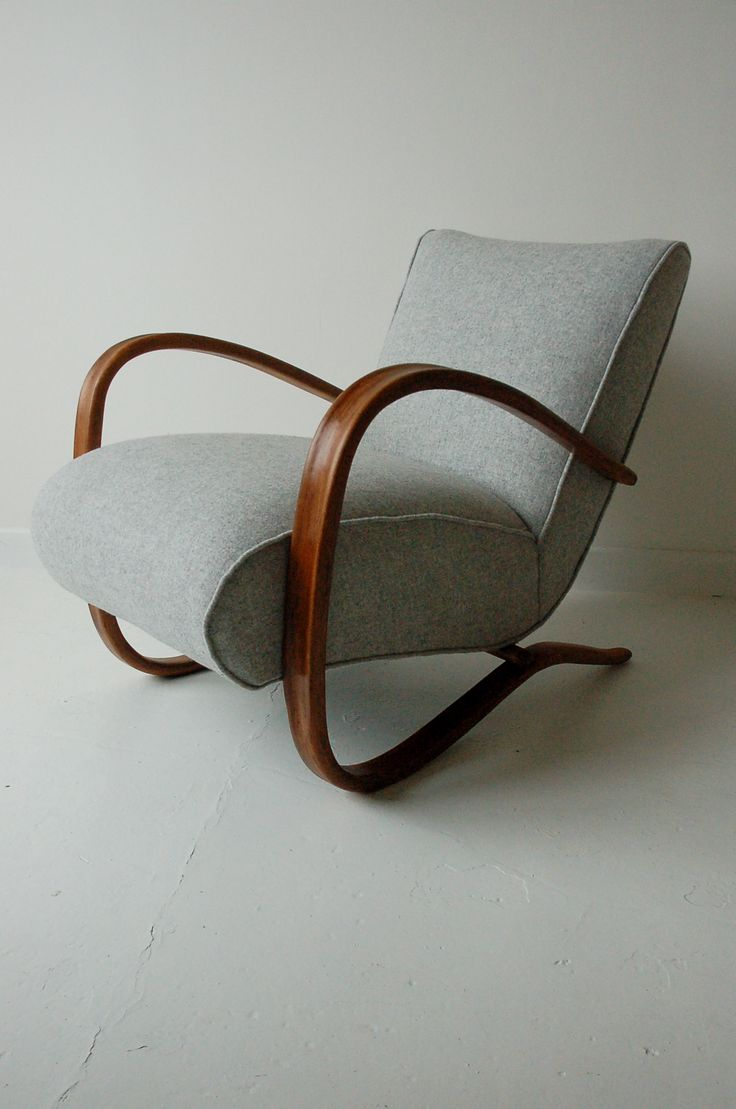 H269 chair by Jindrich Halabala. I would love to use this as inspiration for a poang hack, make new, thicker cushions with covers that wrap the frame and stain the wood teak.