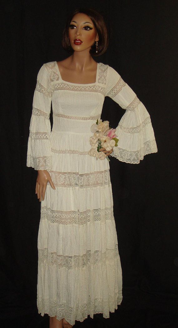 Vintage 1960s White Mexican Wedding Dress with sheer lace and bell sleeves by designer Gonzalo Bauer