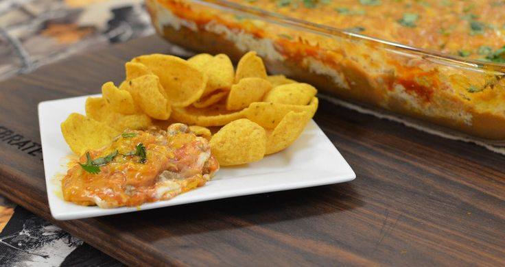 This venison taco hot dip recipe is super easy and cheesy! It's a HOT taco dip, not your run of the mill cold taco dip, so your guests will be pleased!