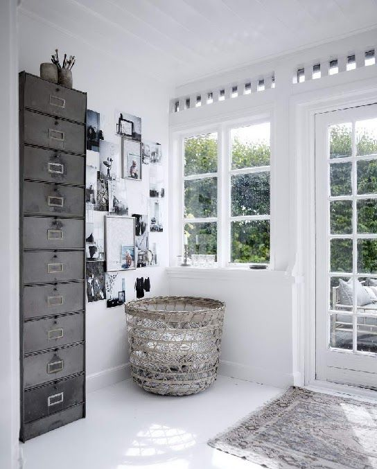 The Industrial Metal Storage Cabinet Makes A Real Style Statement In This  Crisp White Minimalist Space