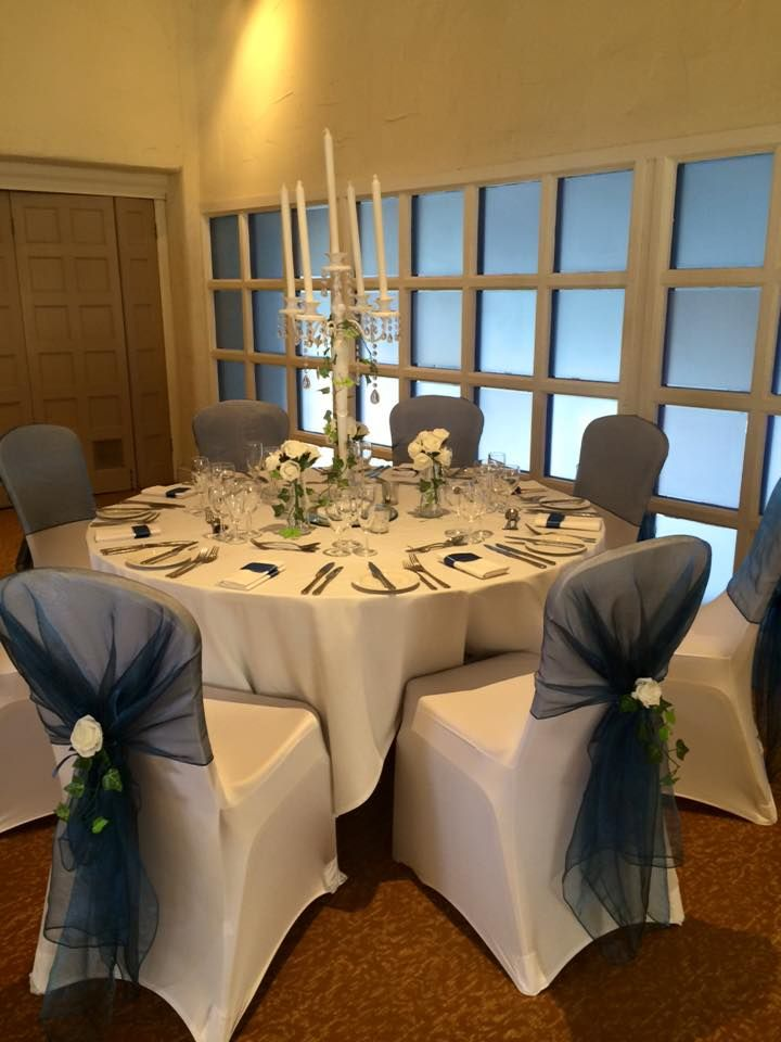 White candelabra with crystal droplets.  Hire in The Midlands from Make It Special Events. http://www.makeitspecialevents.co.uk/