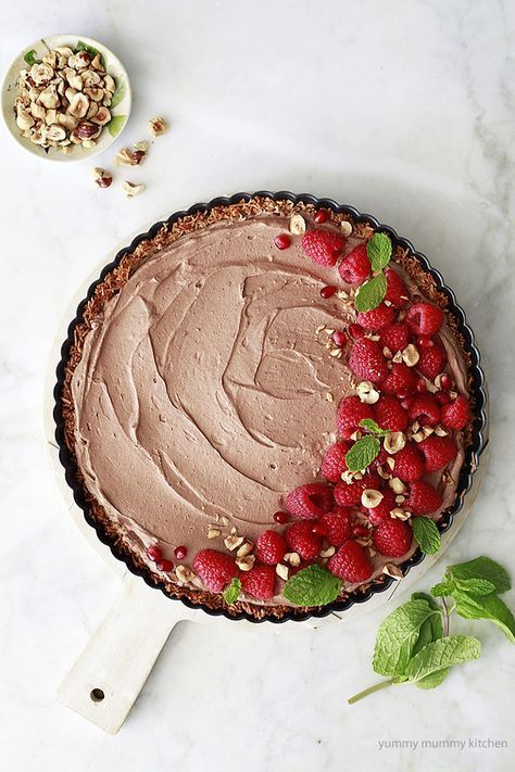 chocolate mousse pie with coconut crust, raspberries, and hazelnuts ...