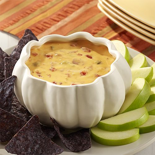 Queso dip recipe with addition of onion simmered in hard cider for a great variation to serve with chips or apple slices.  Velveeta® is a registered trademark of Kraft Foods, Inc.  Ro*Tel® and Parkay® are registered trademarks of ConAgra Foods RDM, Inc.