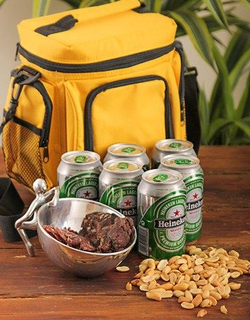 Buy or Send a cooler bag filled with delicious snacks, sliced beef biltong, peri-peri cashews and a Heineken six pack. Please note the bag colour will vary according to availability..N.B.Bag colour will vary according to availability, Excludes silver bowl in South Africa. | Item Code RA029