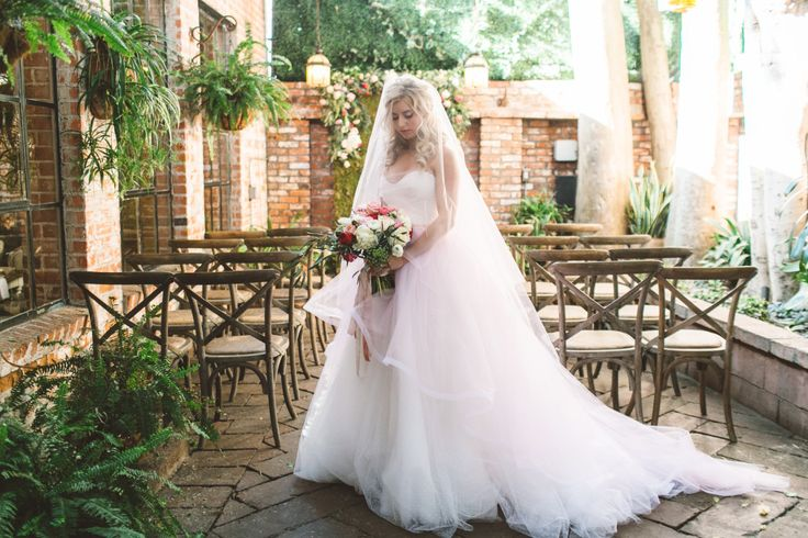 Photographer: Anna Delores Photography  Venue: Carondelet House  Florist: Pristine Design  Wedding Gown:R-Mine  Cakes: Frost it Cakery  Menswear: Friar Tux  Invitations: East Six  Hair & Makeup: Beach Bridal Beauty  Rentals: Pretty Vintage Rentals  Tabletop: Dish Wish  Videography: Miguel Garcia Studios