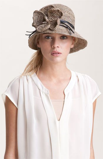Raffia Cloche at Nordstrom.com. A handmade raffia cloche is wrapped with leather bands and embellished with a bloom.