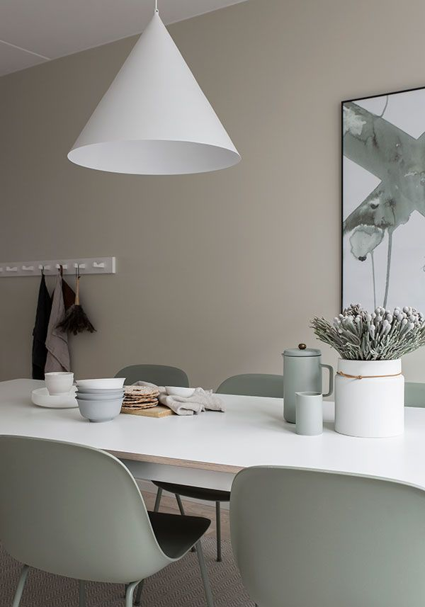 Dining room. Beige walls and gray-green details.