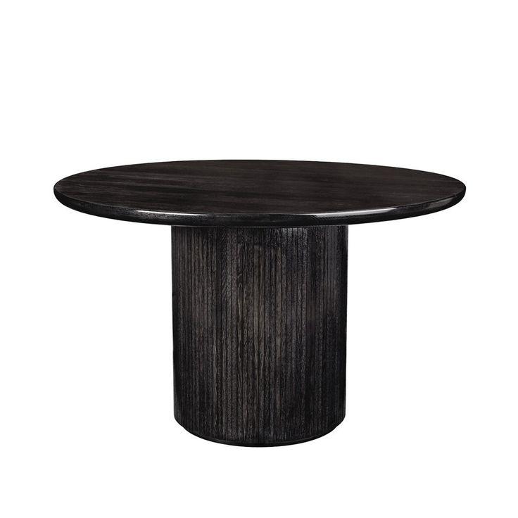 """Round Moon Dining Table is van het merk Gubi. Een tafel van heel zwart hout met een finish eroverheen.  Prijs: 6750,- afmeting: D 47.25"""" x H 29"""""""