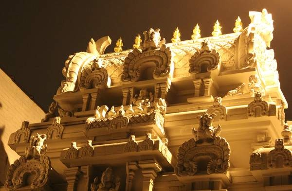 The facade of the Ganesh Temple in Flushing, Queens, illuminated at night.