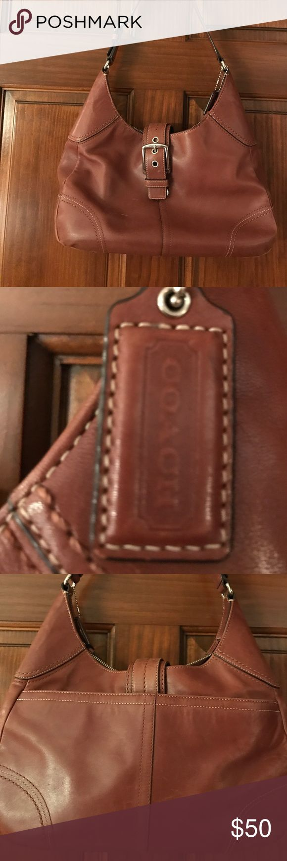 Brown coach hobo bag Brown coach hobo bag.  Very good used condition.  Leather is a soft but no tears. Coach Bags Hobos