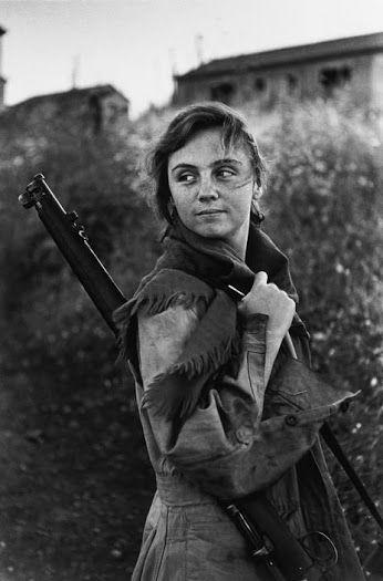 Female soldier guarding the oil pipeline terminal, Haifa, Isreal - David Seymour, 1951