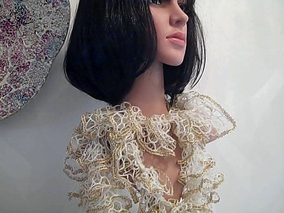 8. Luxury Loopy Glitter scarf ivory with gold glitter edge adds glamour to jackets jeans and jumpers. by handknitteduk. Explore more products on http://handknitteduk.etsy.com