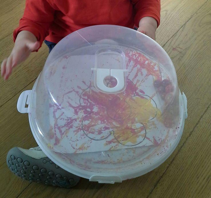 Mark making activitiy using marbles and paint.