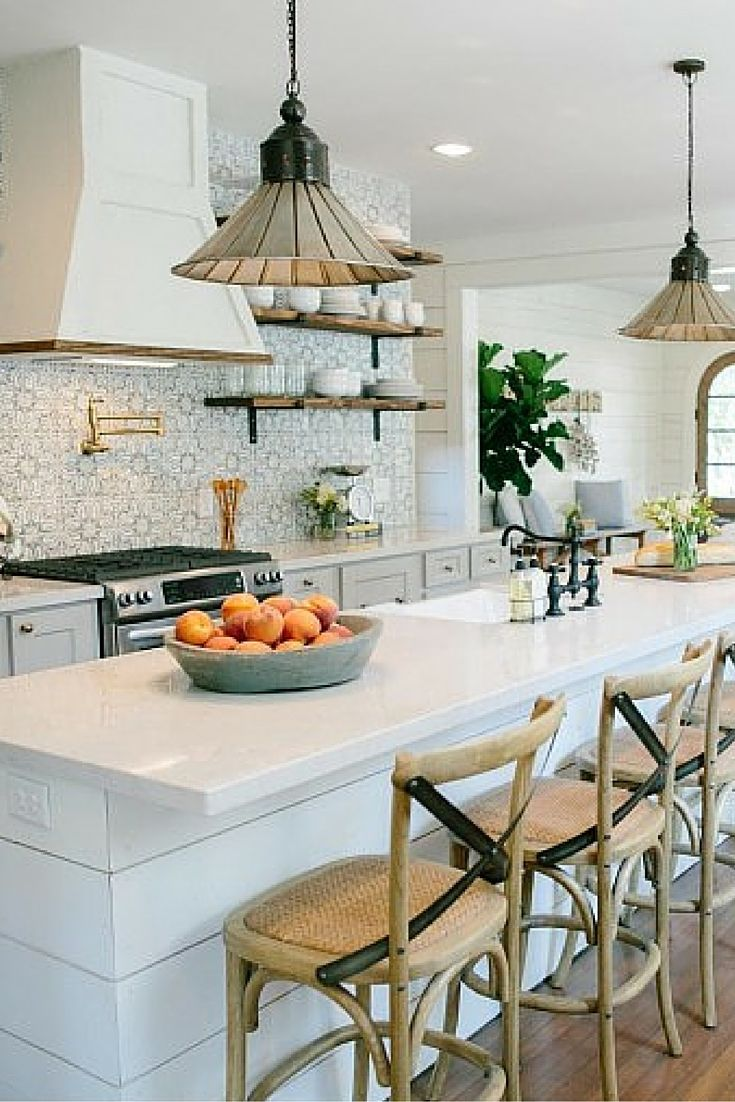 I like how the kitchen is simple but made unique by the backsplash. Very pretty.